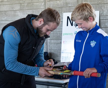 Junior club member Riley proud to get his bat signed by Kane Williamson.